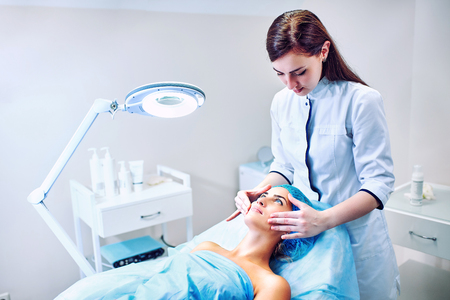A woman cosmetologist at work in the hospital