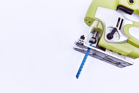 Electric fret saw for cutting wood closeup  .