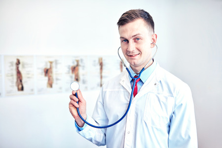Close-up of a doctor in front of a bright background