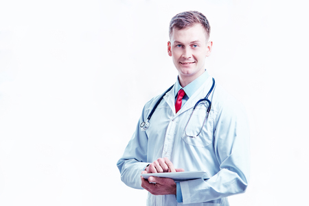 male doctor with tablet at the office, text messaging.