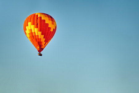 Balloons in the sky above the rocks.