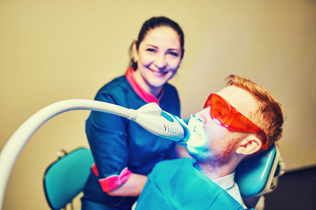 Teeth whitening in dental clinic for pretty patienta