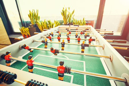 Mini table football foosball soccer with players and ball Stock Photo