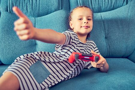 Young kids play video games on their own