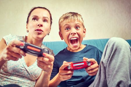 Young woman and child emotionally playing video games