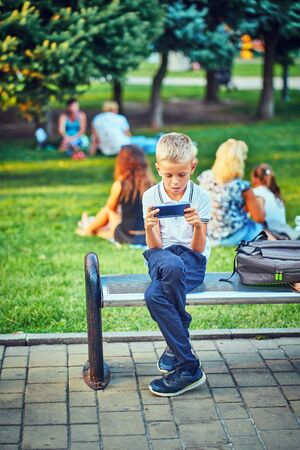 Leisure, children, technology, internet communication and people concept.