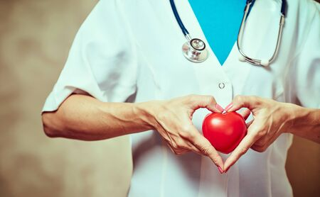 Medical insurance or healthcare concept, doctor holds heart. Stok Fotoğraf