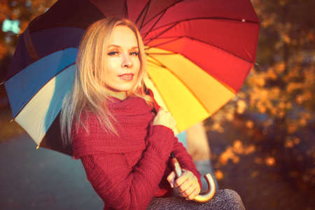 outdoors portrait of young woman with colorful umbrella