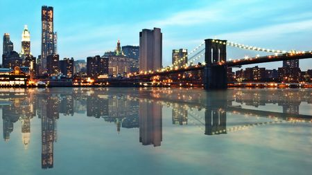 Downtown Manhattan and Brooklyn Bridge at dusk photo
