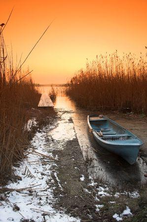 Fishing boat in the freezing lake Stock Photo - 2351902
