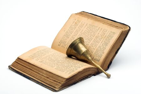 Old book and handbell over white Stock Photo - 2520218