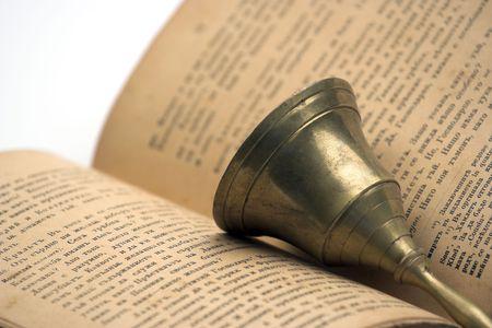 handbell: Old book and handbell close up