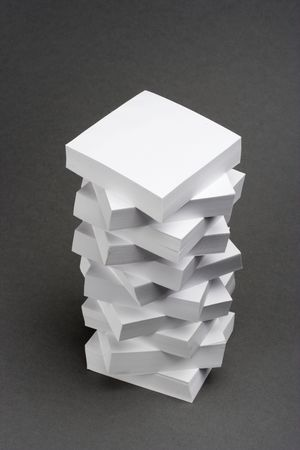 A pile of memo notes over gray background Stock Photo - 2530201