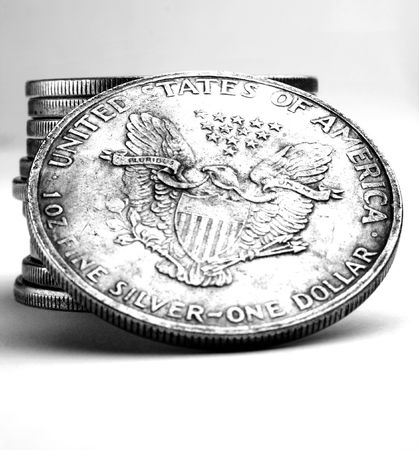 minted: Stack of old dollars and coins