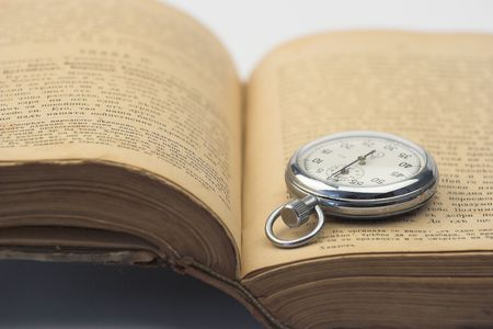 watch over: vintage watch over old book Stock Photo