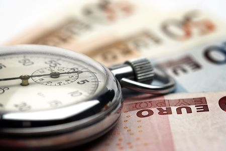 Chronometer and euro bills close up Stock Photo