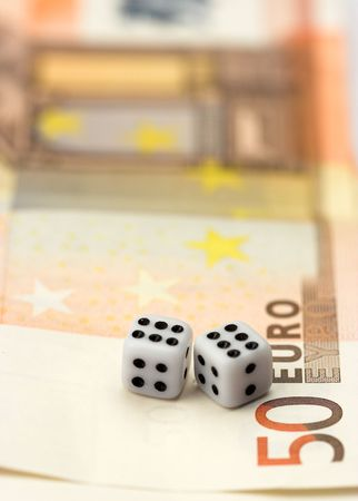 Dices over euro bills close up photo