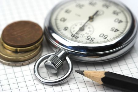 Chronometer and euro cents close up photo