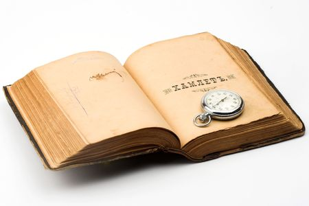 erudition: vintage watch over old book Stock Photo