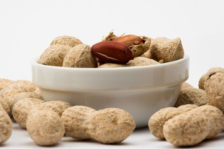 allergic ingredients: Peanuts close up in white bowl Stock Photo