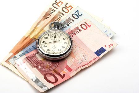 Chronometer and euro bills close up Imagens