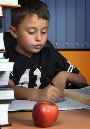 A young schoolboy write his  homework Stock Photo - 3124969
