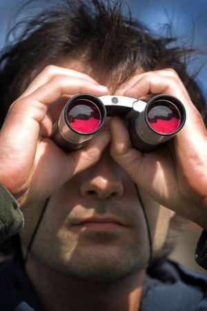 Man look through the  binoculars Stock Photo - 3170358