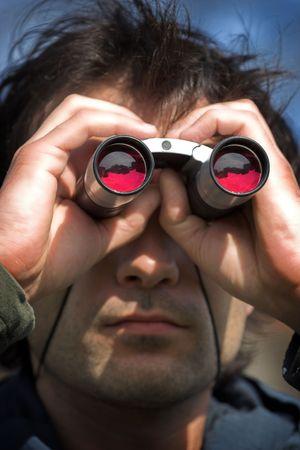supervise: Man look through the  binoculars Stock Photo