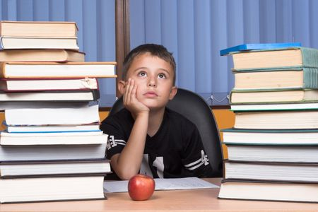 A young schoolboy write his homework Stock Photo