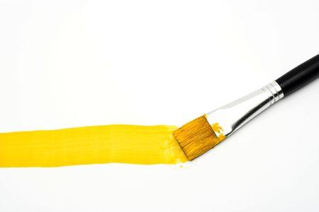 Yellow line and brush over white Stock Photo