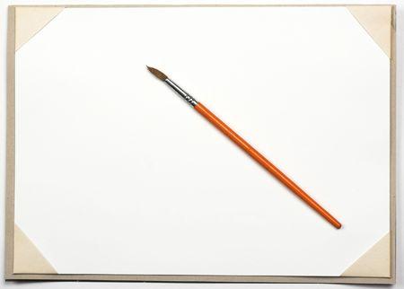 empty drawing block and brush Stock Photo