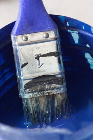 brush with blue handle close up photo