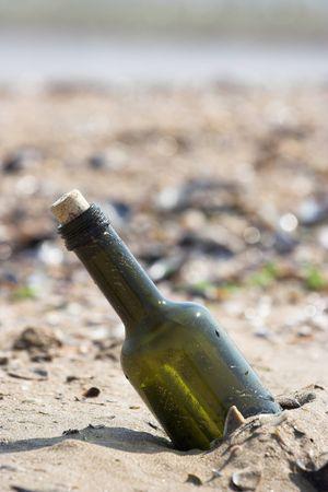 castaway: Message in the bottle on empty coast