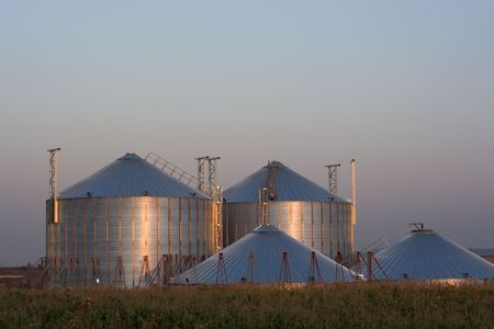 View of grain silos at sunset photo