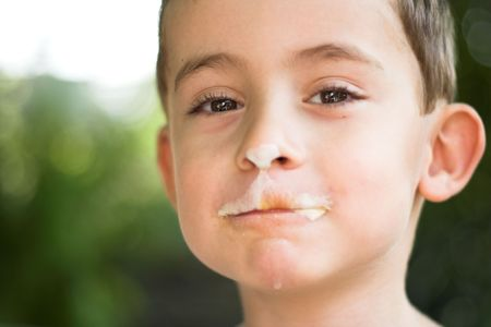 boy eating ice-cream close up Stock Photo