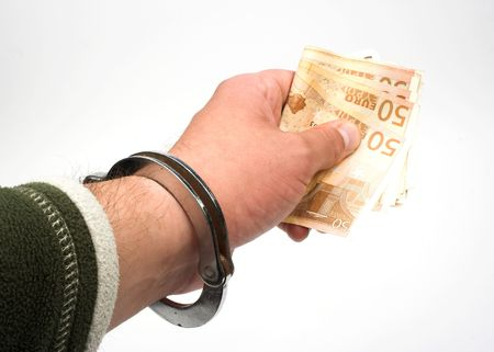 ransom: hand in chains giving money Stock Photo