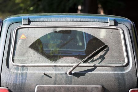 The dirty back window of an automobile Imagens - 3680966