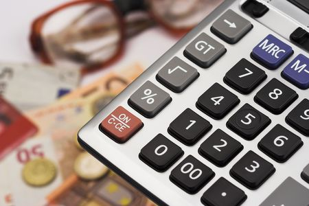 calculator over euro bills and coins Imagens - 3749346