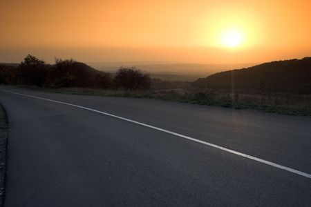 a empty road at sunset