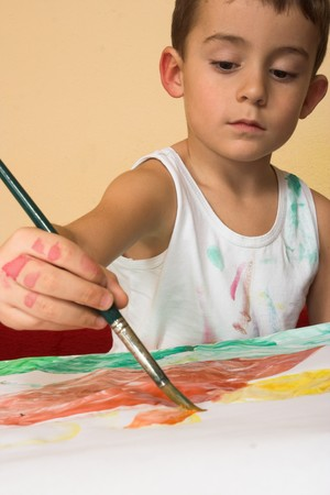portrait of a painting boy Stock Photo