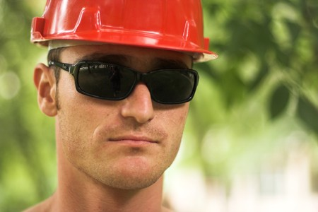 young worker with red helmet photo