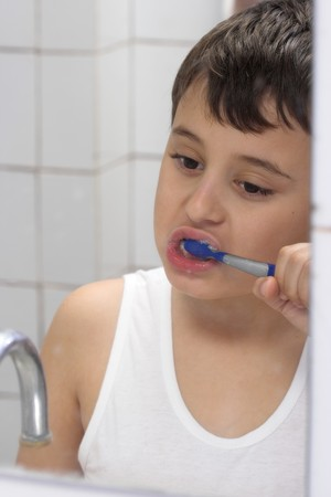 young boy brushing his teeth Stock Photo - 4542207
