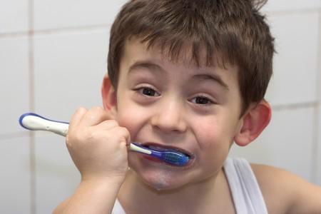 young boy brushing his teeth Stock Photo - 4542217