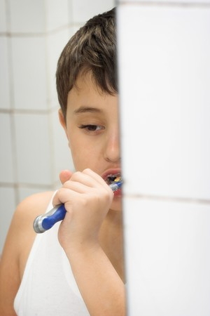 young boy brushing his teeth,reflection in mirror Stock Photo - 4542216