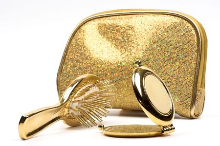 comb,looking-glass and glamour purse over white