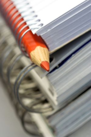 handbooks: stack of notebooks and pencil,shallow dof Stock Photo