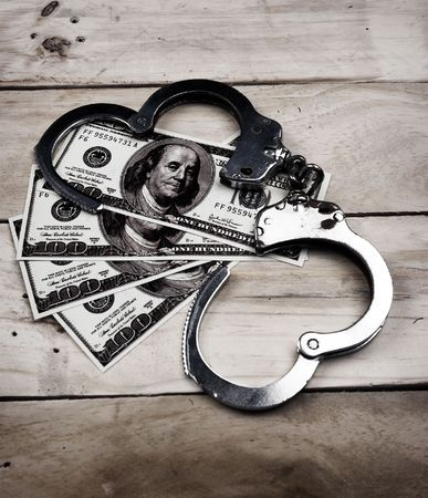 ransom: money and handcuffs close up   Stock Photo