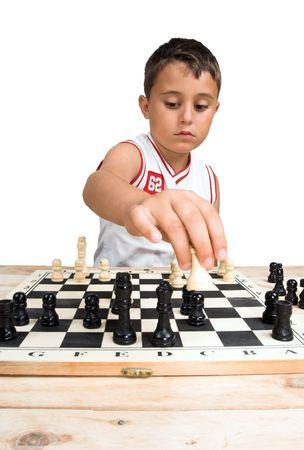 Un niño jugando ajedrez en blanco Foto de archivo - 5102944
