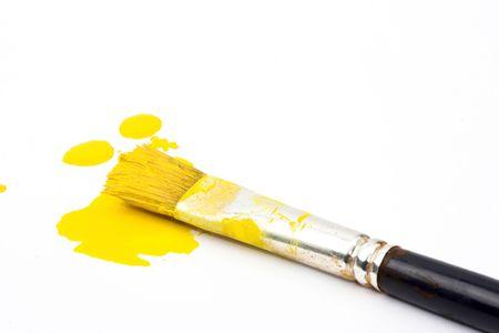 splashes of yellow paint and brush Imagens - 5245275