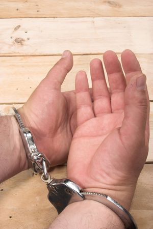 Handcuffs on the man's hands Stock Photo - 5285518